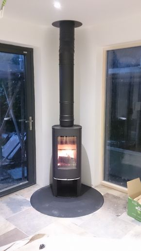 The Scan 45 mini is a popular choice because of it's slim-line design and beautifully tall flame picture. installed by Kernow Fires on a tear-drop steel shaped hearth. #scan #mini #fire #stove #wood #burner #corner #doors #modern #contemporary #tear #drop #shaped #steel #hearth #freestanding #kernowfires #wadebridge #redruth #cornwall