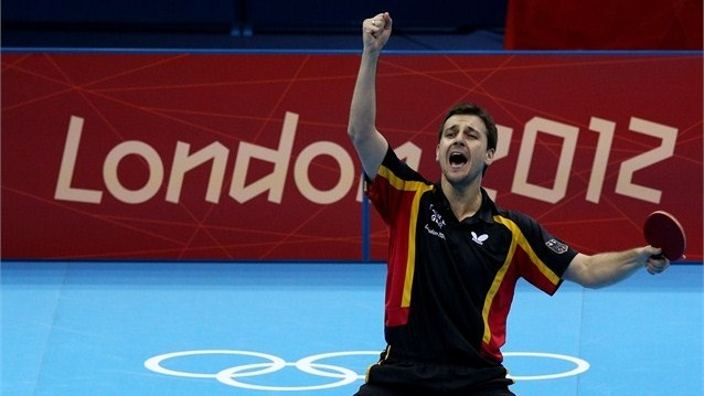 Timo Boll celebrates defeating Tianyi Jiang  Timo Boll of Germany celebrates defeating Tianyi Jiang of Hong Kong, China and winning the Men's Team Table Tennis bronze medal match on Day 12.