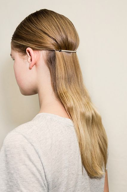 Unexpected Accessory At Tibi, the stylists teased the hair behind the ears, and combed the rest of it backwards. Then, they secured it with bungee elastics that matched the models' hair colors, which added a graphic element. Who knew your ponytail holder could look so current?