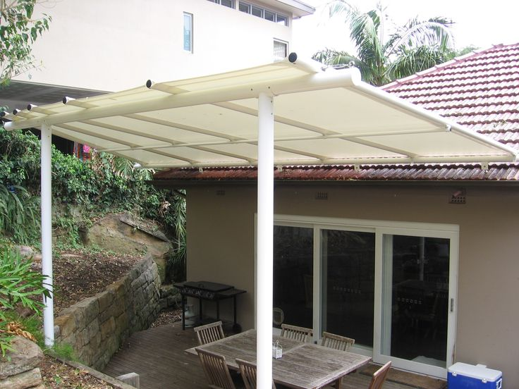 A reverse pitch batten awning allows more light and a view for this home