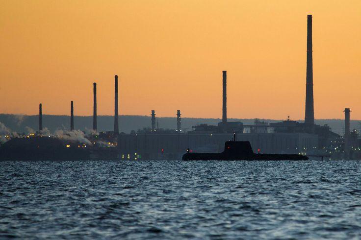 A Royal Australian Navy Collins-class submarine in Cockburn Sound at sunrise. [2014x1366] [OS]