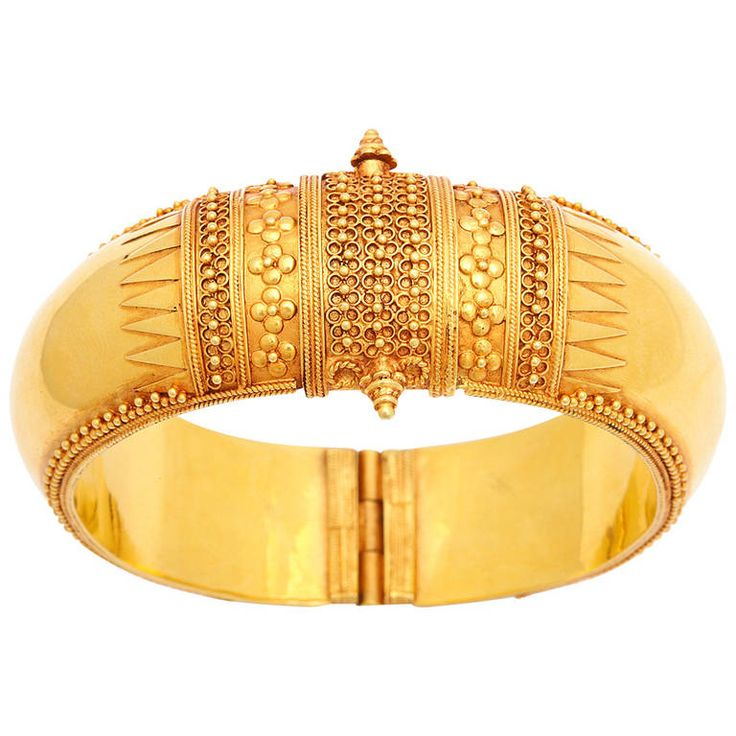 Temple Flower Bracelet. An 18kt yellow gold contemporary temple style bracelet. The bracelet is adorned with flowers, leaves and scrolled vine work. India, 2013