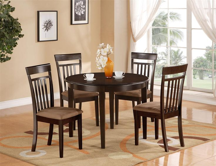 Kitchen:Round Black Dining Table Brown Dining Chairs Modern Area Rugs Wall  Decorations Decorative Plants