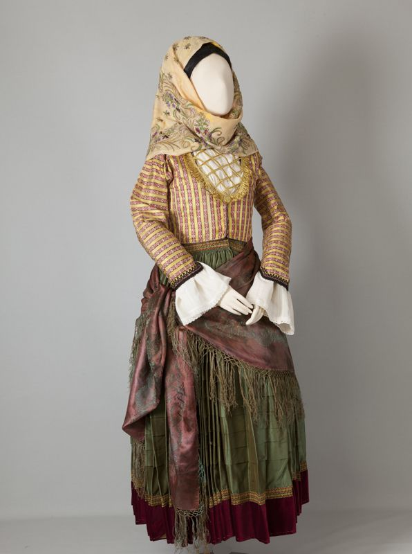 Women's costume of Spetses, Argosaronic Islands Early 20th century ©Peloponnesian Folklore Foundation, Nafplion, Greece  The costumes of Spetses, Hydra and the Ermionida region generally used to have a pleated green dress with a crimson velvet hem and a zipoúni of brocade imported from Western Europe or the East. Later, the dress of the Spetses costume...