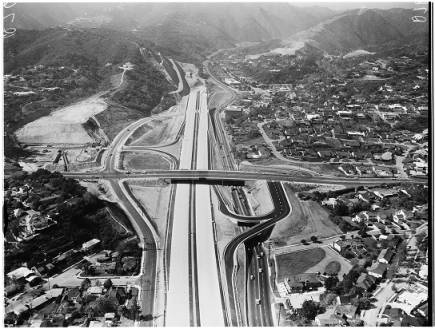 Aerial view of San Diego Freeway from Wilshire Boulevard to Sunset Boulevard, West Los Angeles, 1957 :: Los Angeles Examiner Collection, 1920-1961