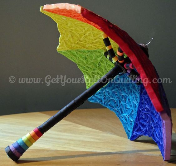 Le parapluie (The Umbrella) is a stunning 3D quilled creation brought to life by paper filigree artist Kristen Brunton of Get Your Roll On Quilling!