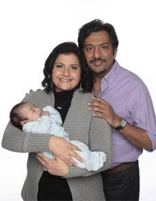 Zainab and Masood (played by Nina Wadia and Nitin Ganatra) with baby Kamil - Eastenders, BBC