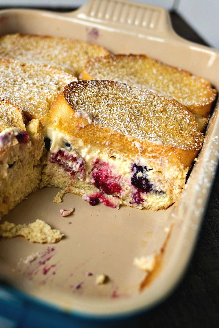 Slices of French bread stuffed with fresh berries & cream cheese filling, covered in a custard mixture and baked until perfectly fluffy and slightly crispy on top.