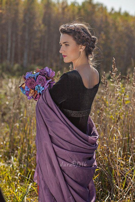 Изысканная невеста в черном платье.