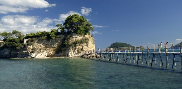 Small island in front of Laganas' harbour, it is connected to the mainland with a wooden bridge enlightened at night.