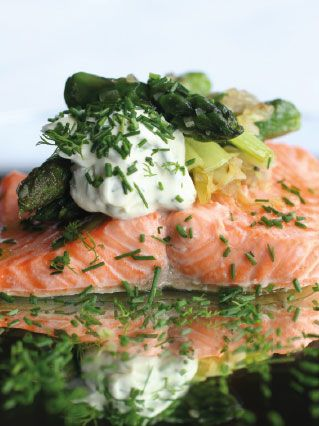 Asparagus with grilled trout, chive and dill crème fraîche. Follow link for full recipe from appetite, North East England's dedicated food & drink publication.