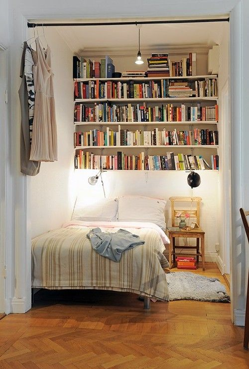 Book shelf storage above bed hanging clothing and or How to store books in a small bedroom