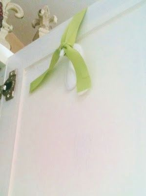 3M command hooks upside down to hang wreaths on cupboard doors