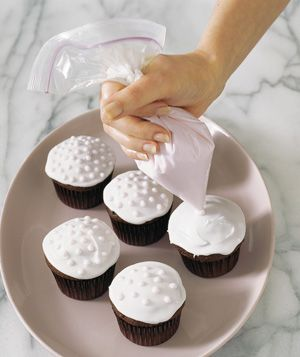Zippered Plastic Bag as Frosting Dispenser - If you don't have a pastry bag, you can use a plastic bag to decorate a cake or cupcakes. Scoop frosting into the bag, seal it shut, snip off a tiny corner, and start piping.