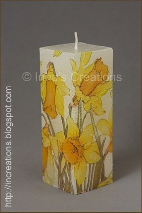 Decoupage candle with daffodils.