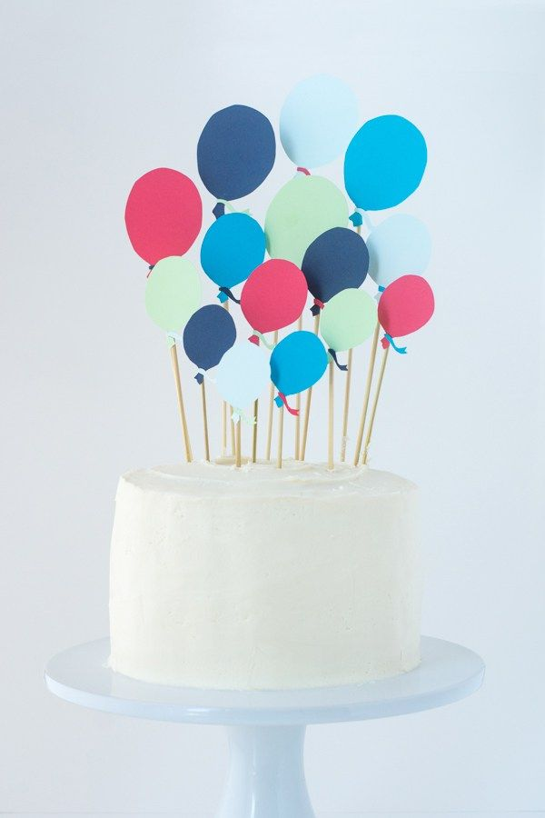 A cute birthday cake complete with DIY paper balloon cake toppers!
