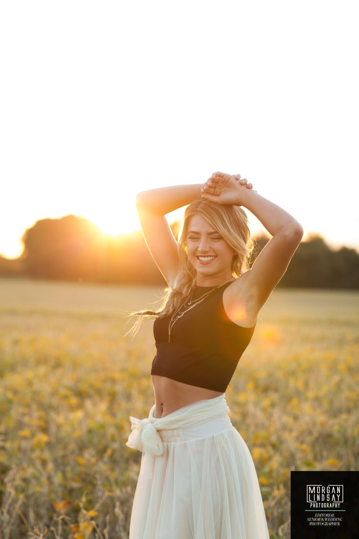 Senior girl picture ideas gorgeous yellow flower field with gorgeous lighting classic black and white outfit inspiration fishtail hair inspiration for senior pictures