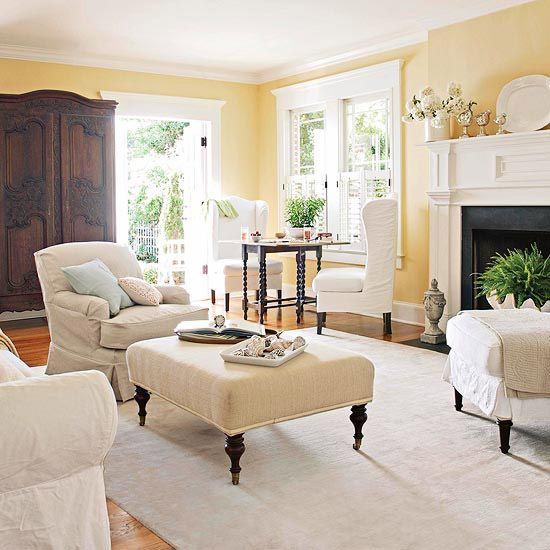 Define spaces within rooms with the addition of an area rug. A large rug draws a seating arrangement together to create a more intimate setting.