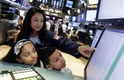 The Dow Jones industrial average inched up half a point to eke out another record high at 17,828.24.