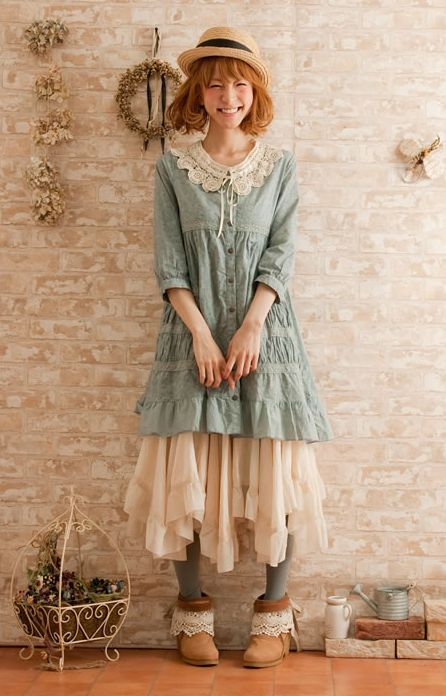 Aw, she giggles! A varying hem-line on the skirt adds mori quirkiness to the outfit.
