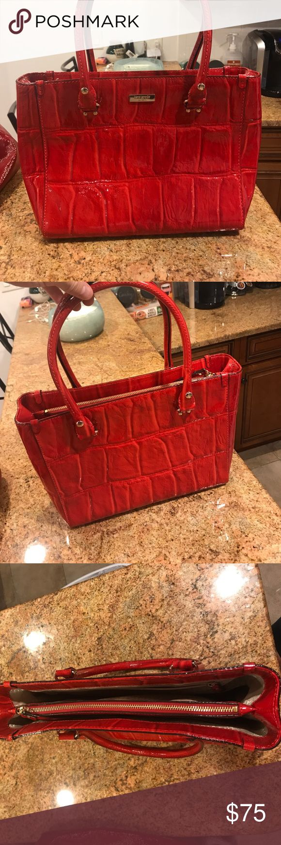 Kate Spade Bag Up for sale. 100% Authentic Kate Spade handbag. This red bag is sure to standout anywhere you go! Very lightly used and in great condition! 13 x 10 Kate Spade Bags
