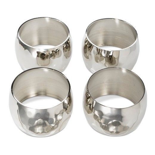 Make your dinner party shine with the Silver Large Hammered Napkin rings (Set of 4) from Threshold. These silver napkin rings have a bowed shape with hammered finish to reflect more light.