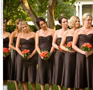 Beautiful Brown dresses for bridesmaids and autumn flowers in the bouquets