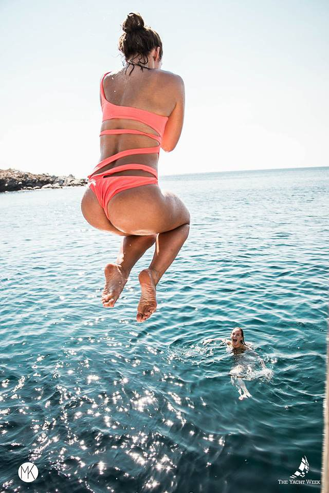 Jumping in the sea at The Yacht Week Greece   Thinking about doing The Yacht Week? Here's the ultimate guide to The Yacht Week Greece! Full ofday parties, beautiful sunsets in jaw-dropping locations, and the world famous Nikki Beach party!