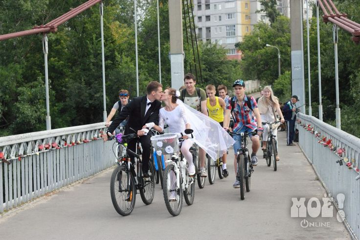 Wedding on bicycles in Voronezh    The  locks on the bridges are put their by the brides and grooms as a sign of their unending love of each other.