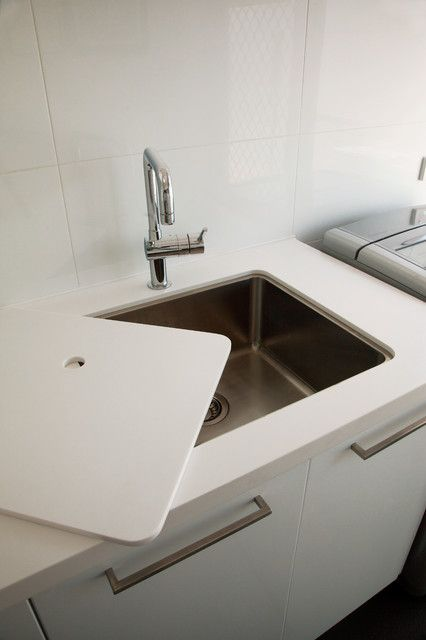 Increase bench space Having a small laundry with little usable bench space can be a challenge. One clever way to increase the available work area is to make must-have items multi-functional. This fitted sink cover that doubles as a benchtop extension is one smart solution to the problem.