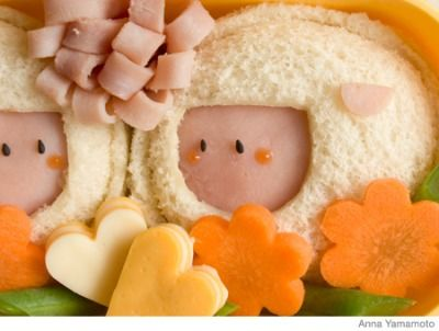 How to Make a Sheep Bento Lunch Box: make a sealed ham sandwich and cut out a space for the sheep's face, cut out smaller piece of ham for the ears, make flower carrots and string bean fields, add a ham flower,