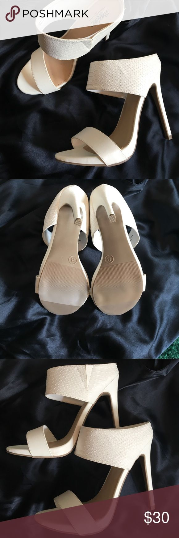 """Sexy white strappy heels Sexy, white, faux snake print heels. Heel is 5"""", with 1"""" platform. Never worn. Look great with jeans, or dressed up!!! Shoes Heels"""