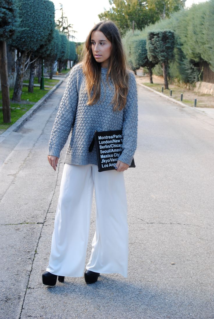 Shop this look on Lookastic:  http://lookastic.com/women/looks/grey-cable-sweater-black-and-white-clutch-white-wide-leg-pants-black-ankle-boots/6443  — Grey Cable Sweater  — Black and White Print Leather Clutch  — White Wide Leg Pants  — Black Leather Ankle Boots