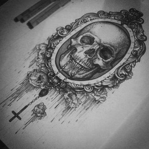 Awesome tattoo design - a skull with amazing frame around him. just NO upside down cross! Perfect thigh tattoo