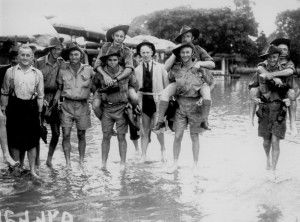 Soldiers enjoying a day at the races despite the storm at Albion Park Brisbane, January 1941. John Oxley Library, State Library of Queensland. Neg 66218