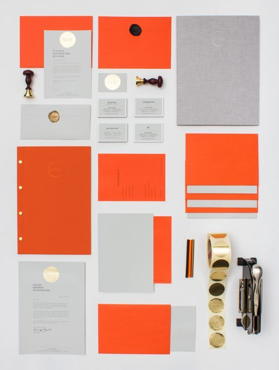 A very nice use of gold metallic for just that extra something. The bright orange matches well because it is also a warm color. I like how the envelopes are sealed with wax. The designer is LSDK. #stationery #design