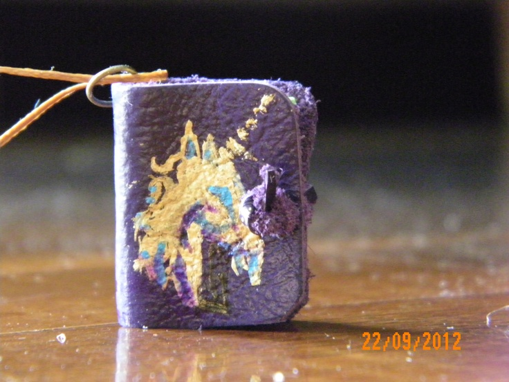 Unicorn Handmade Mini Leather Book pendant with purple leather and colored paper.
