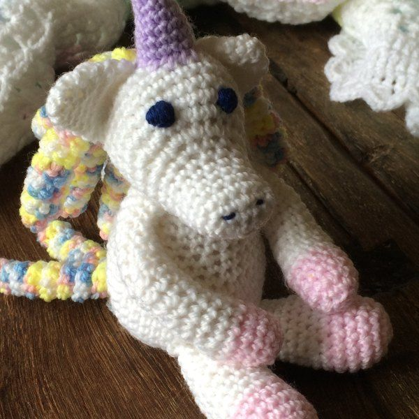 """Annabelle the Unicorn is """"The Next Precious Animal MCAL"""", this MCAL was in May 2015.You will need… Yarn Color A - about 100 yards (Hobby Lobby's I Love This Yarn in Iced Violet) Yarn Color B - about 20 yards (Hobby Lobby's I Love This Yarn in Hot Orchid) Yarn Color C - about 4 yards - (Loops and Threads Impeccable Solids in Soft Rose) Yarn Color D - about 80 yards - (Red Heart Super Saver Solid in Perfect Pink) 12mm safety eyes or desired size 3.25mm crochet hook (Size D), or desire..."""
