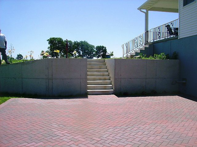 Red Brick Patios | large red brick patio and retaining wall