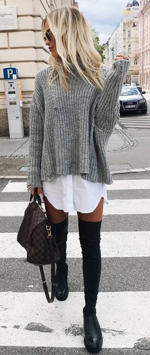 Gray sweater over white tunic shirt with black OTK boots.