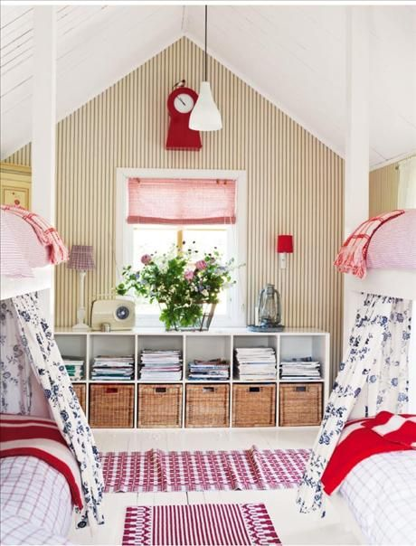 Cottage-style bunk beds in red and white. Practical storage solution, too.