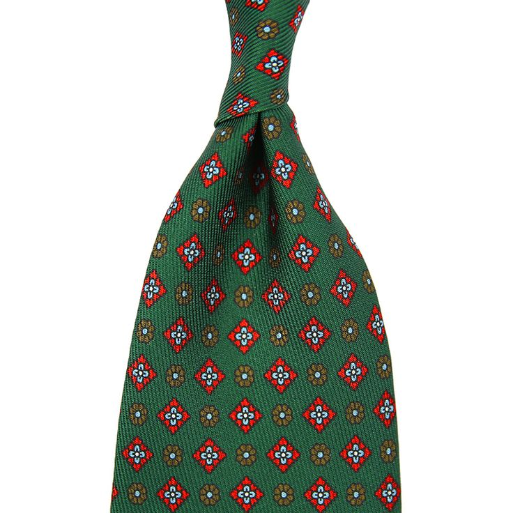 Handmade in Italy Fabric: 100% silk Length: 147cm (= 58 inch) Construction: 7-fold hand rolled 7-fold tie in a fresh and beautiful shade of green with a floral pattern in cherry red and olive. Made from heavy...