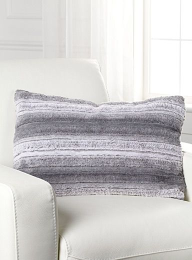 Exclusively from Simons Maison   Luxurious faux fur cushion that warms any decor with lush velvety texture in rich grey shades for a fashionable urban look.   - Washable with removable cover  - Easy-care polyester fibre  - Matching throw also available  - 40 x 60 cm