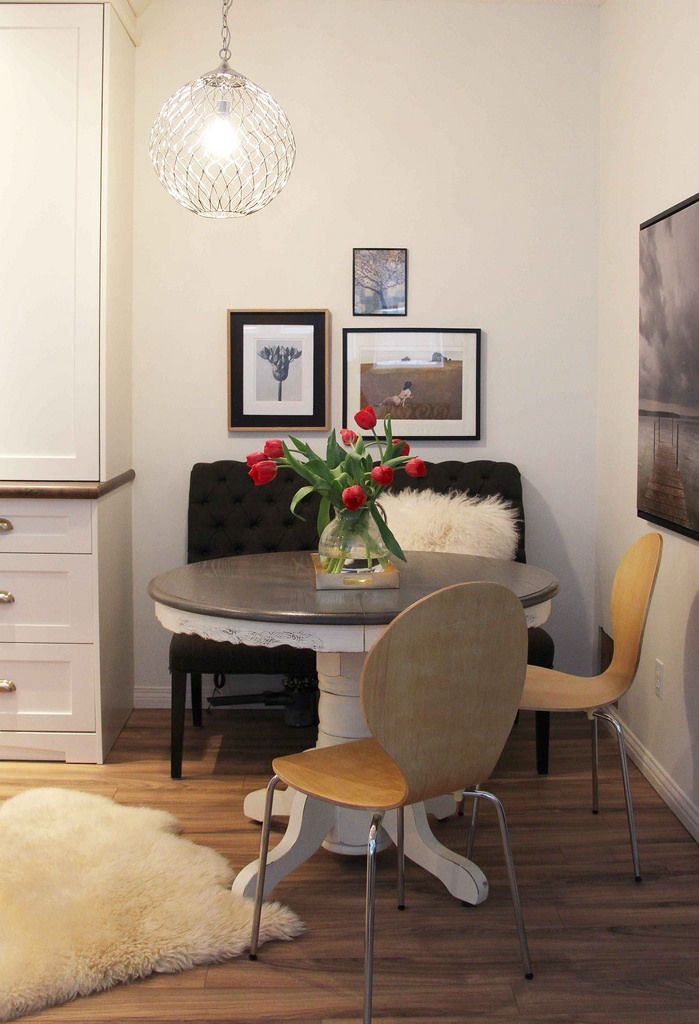 eating area with banquette, modern chairs, gallery art and sheepskin