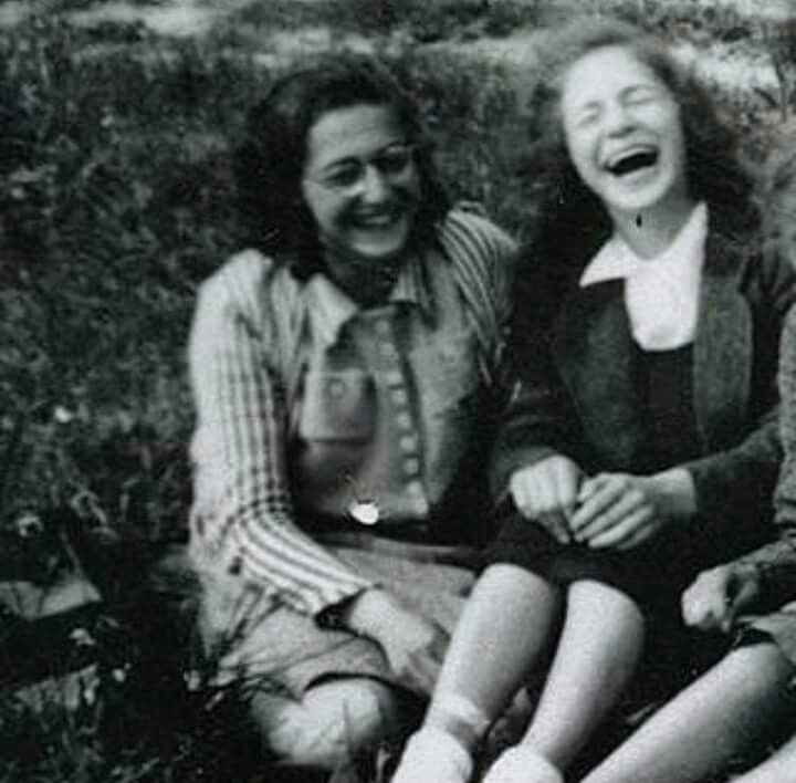 That striped cardigan, bottoned shirt, and pencil skirt makes for a neat picnic outfit. 1941, somewhere in the Netherlands - Maccabi Hazair related gathering.  Also, she looked really adorable with that smiling laugh.