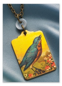 Love the use of the button to attach the pendant to the chain, and the great colors in the pendant.