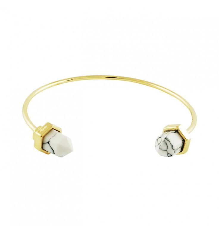 Gouden armband met marmeren steen aan elke kant.