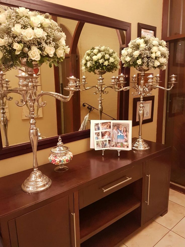 Candelabra with flowers at entrance