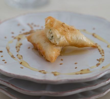 Phyllo Triangles Stuffed with Fresh Cheese Briouats Bil Jben Photo - Party Hors Doeuvres Recipe | Epicurious.com
