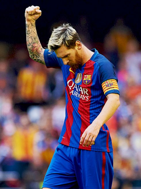 """"""" Lionel Messi celebrates scoring his team's third goal during the La Liga match between Valencia CF and FC Barcelona at Mestalla Stadium on October 22, 2016 in Valencia, Spain. """""""
